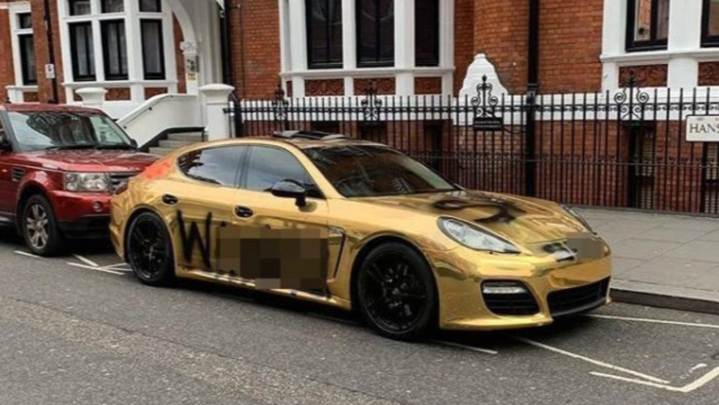 Businessman Has 'Wa***r' Painted On Gold Porsche After Lamborghini Set On Fire