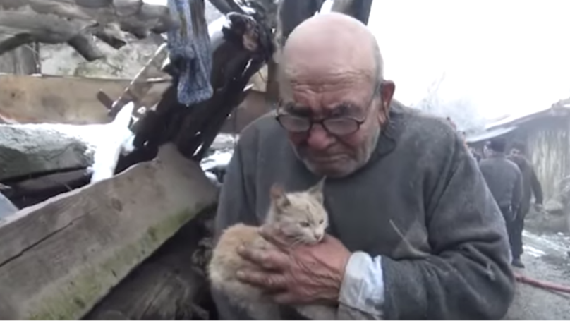 Man Clutches Pet Kitten After Home Is Destroyed