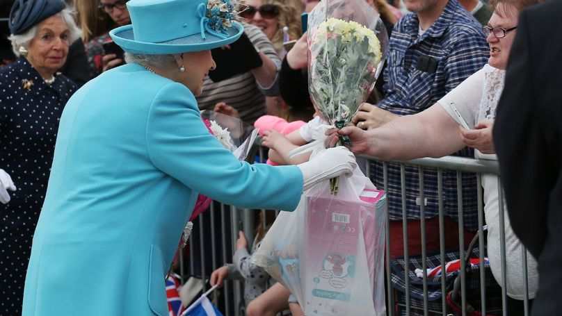 Someone Handed The Queen A B&M Bag Of Toys And She Did Not Look Impressed