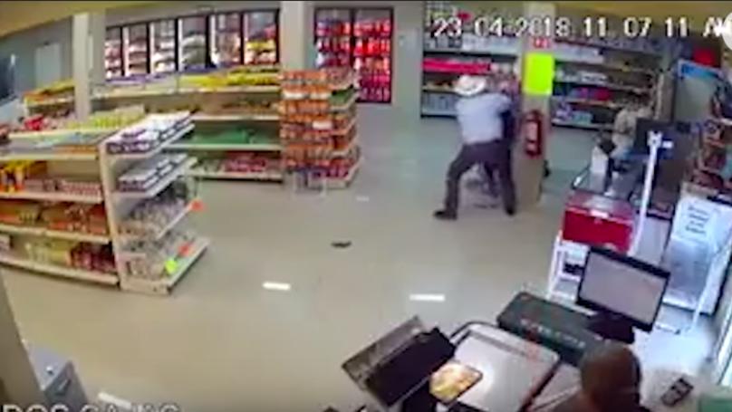 CCTV Footage Captures Cowboy Taking Down Gun-Toting Robber