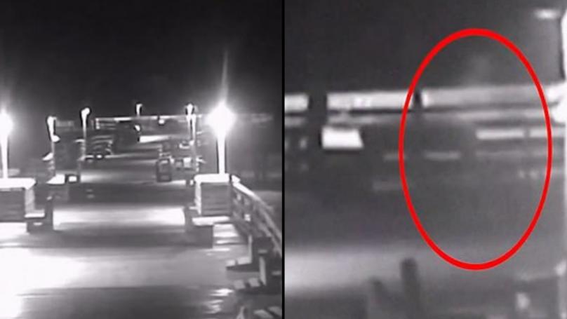 Creepy 'Ghost' Figure Filmed Calmly Walking Along Promenade During Hurricane Florence
