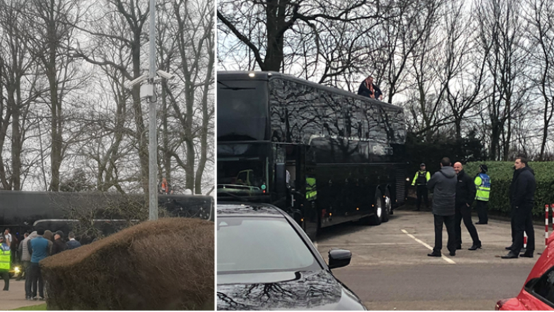 Blackpool Fan On Top Of Arsenal Team Coach, Stopping It From Leaving