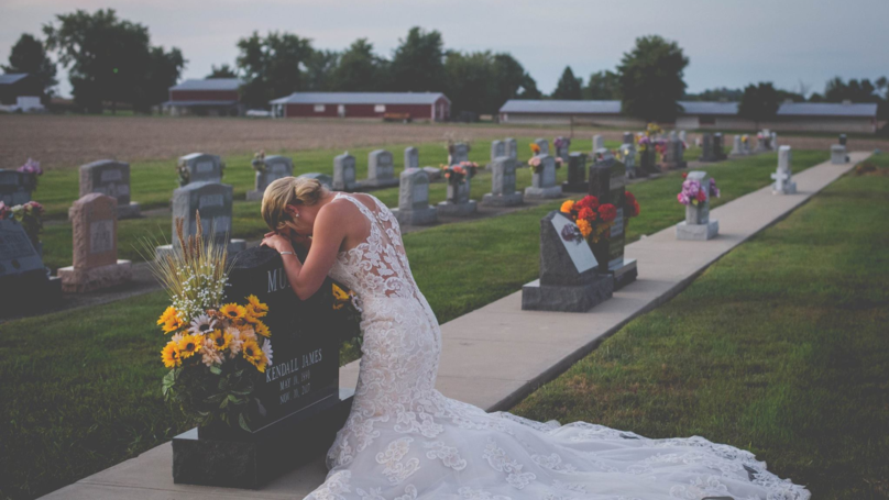 Grieving Bride Visits Late Partner's Grave On Day They Were Set To Marry
