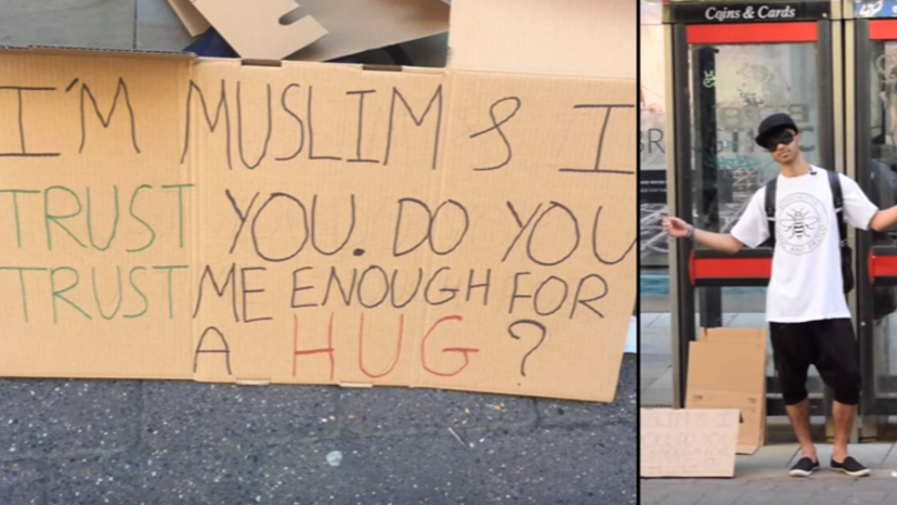 Blindfolded Muslim LAD Stands In Manchester Offering Hugs To Passers By
