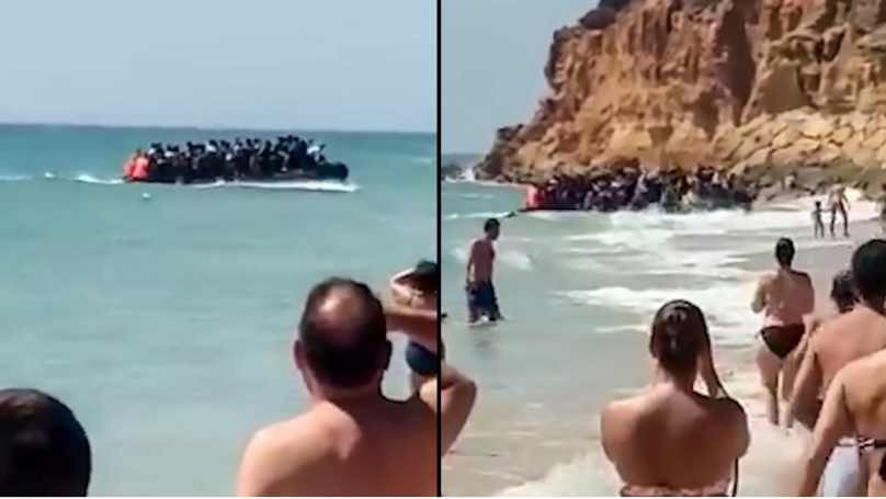 Shocked Tourists Watch 50 Migrants On Packed Boat Storm Spanish Beach