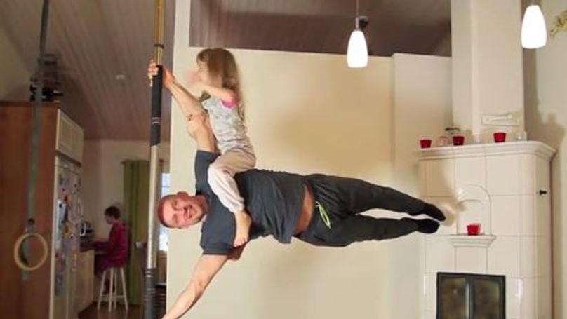 This 49-Year-Old Dad's Home Workout Routine Will Put You To Shame