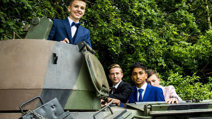 LAD Rolls Up To His School's Prom In Fully Armoured 17-Tonne Tank