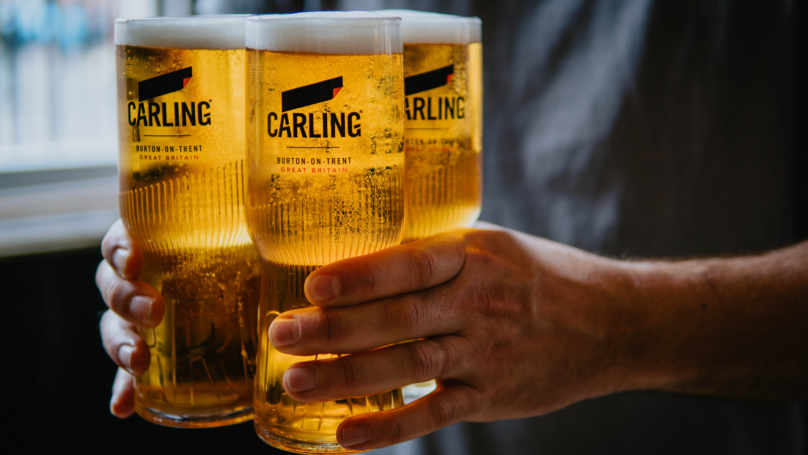 Carling Has Redesigned Its Pint Glasses So You Can Carry Four Easily