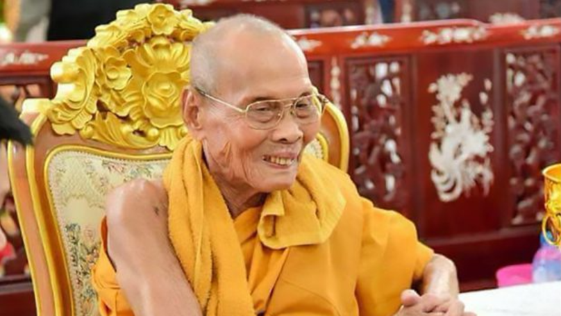 Buddhist Monk Pictured 'Smiling' As Body Is Exhumed Two Months After Death