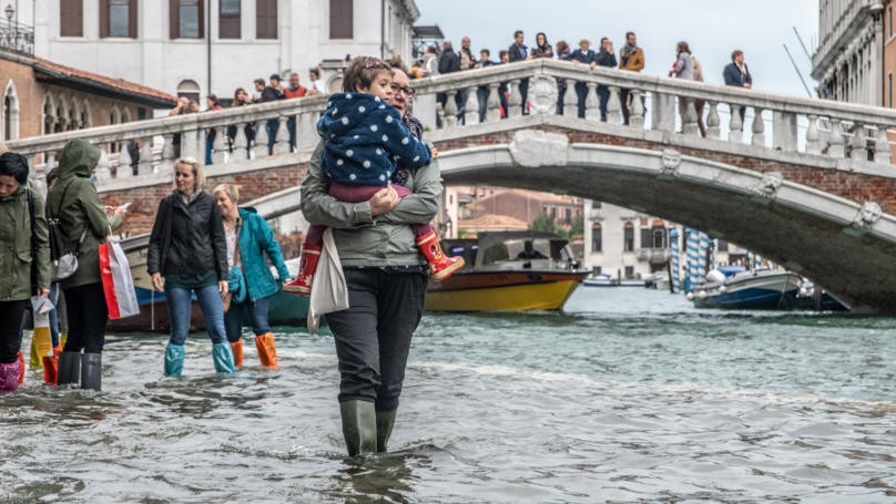 Locals Still Serve Pizza As Venice Suffers Worse Flooding In Years