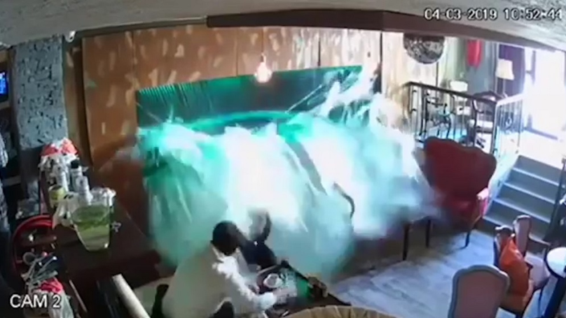 Video Shows Moment Cafe Fish Tank Breaks And Soaks Two Customers