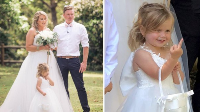Little Girl Photobombs Mum's Wedding Pictures In The Cutest Way