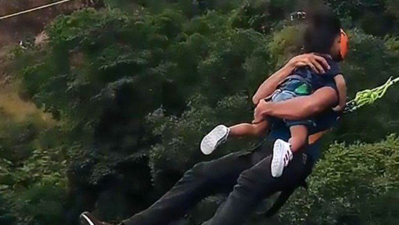 Man Does 60-Metre Bungee Jump While Holding Tiny Daughter
