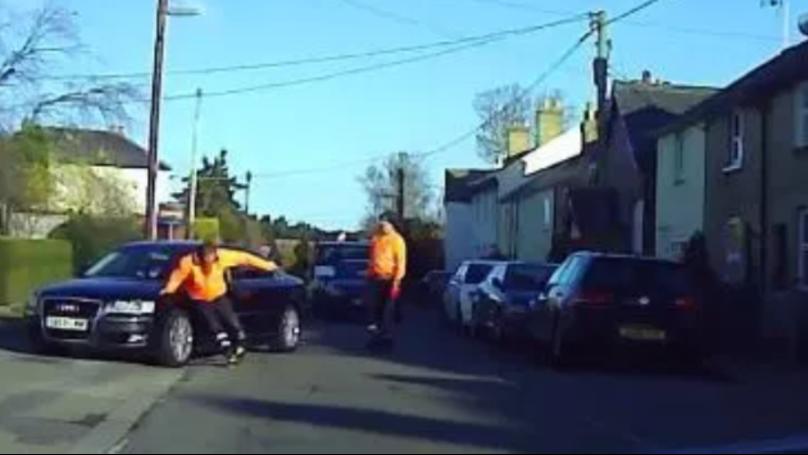 Binman Throws Himself In Front Of Car