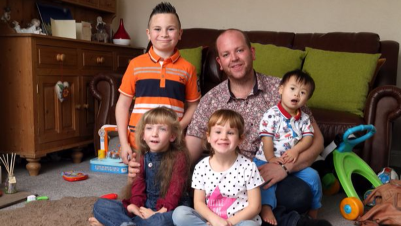 Man Dubbed 'Super Dad' After Adopting Four Children