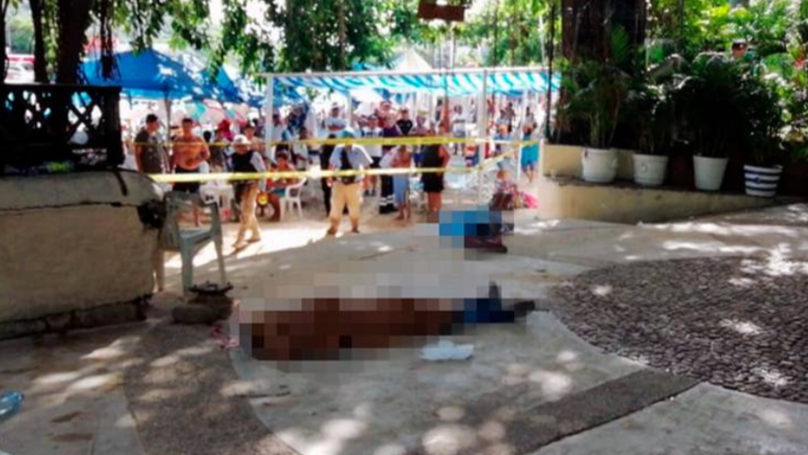 Holidaymakers Soak Up The Sun Just Metres Away From Dead Bodies