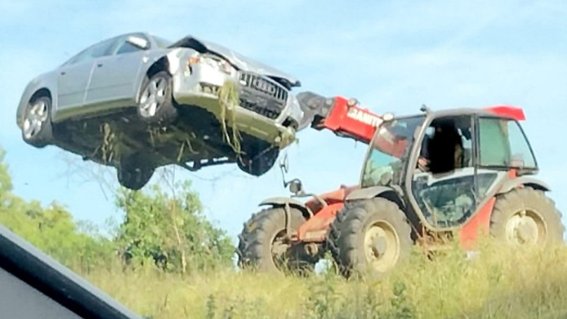 Farmer Removes Abandoned Audi From His Field With His Own Vehicle