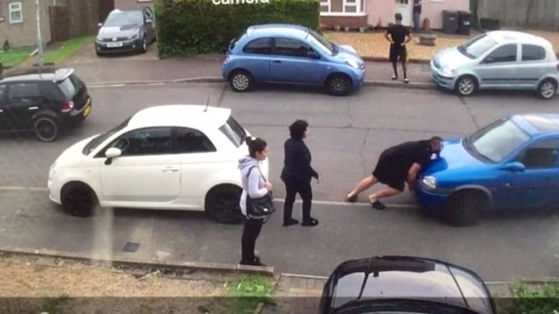 Strongman Picks Up And Moves Car That's Blocking Him In