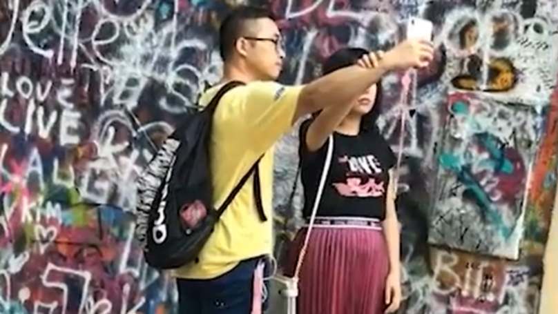 Woman Caught Using Her Boyfriend As A Tripod To Take Selfie