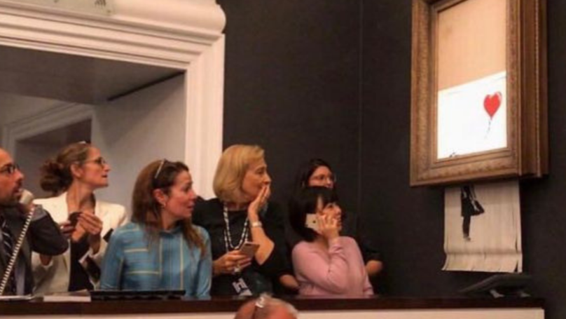 People Think They've Worked Out Who Banksy Is After Self-Destroying Painting Was Sold