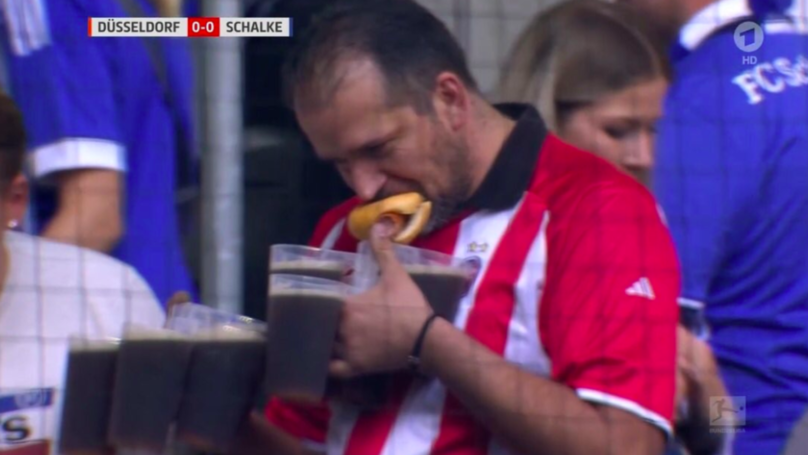 Football Fan Carrying At Least Seven Pints And A Hotdog Is Our New Hero