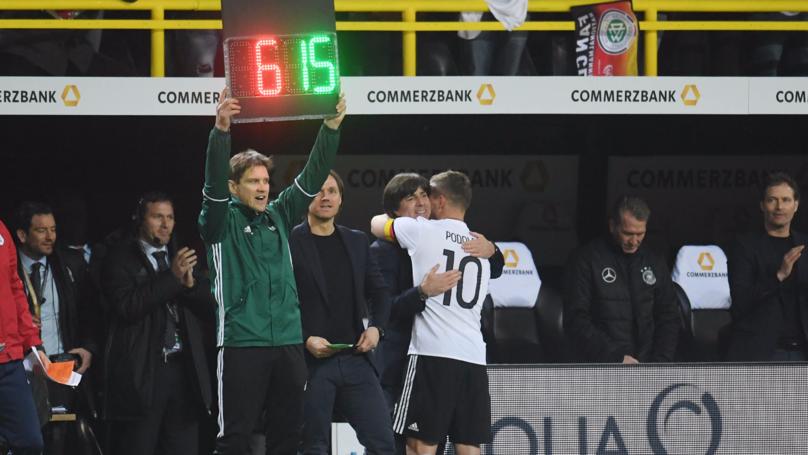 b6989ee76 WATCH  Lukas Podolski s Brilliant Take On Joachim Low s Bad Touchline Habits