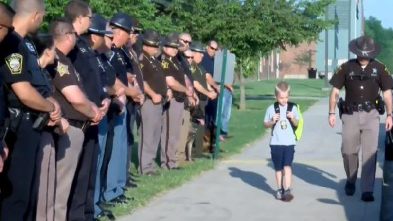 70 Indiana Officers Escort Boy To School After His Dad's Murder