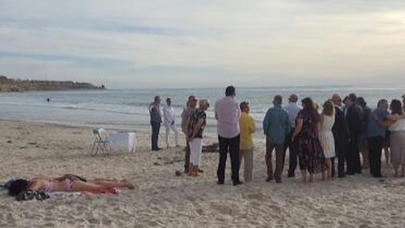Woman Pictured Sunbathing Metres Away From A Wedding In Australia