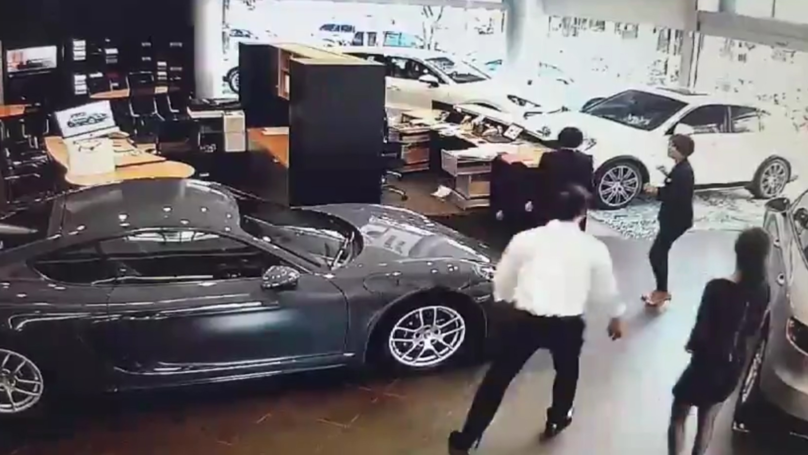 ​Angry Businessman Crashes £100k Porsche Into Dealership