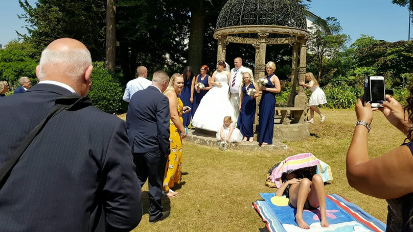 Couple's Wedding Photos 'Ruined' By Sunbather Who Refused To Move