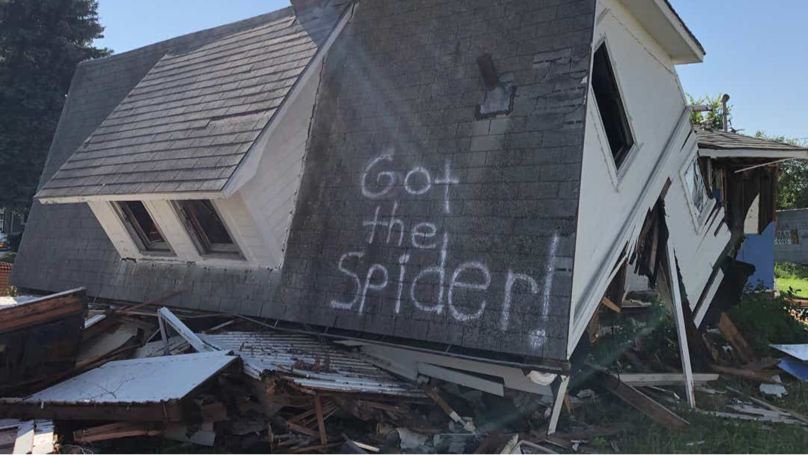 ​Message On Torn-Down House's Roof Goes Viral