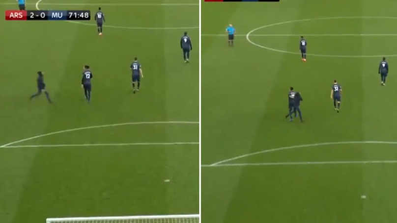 Pitch Invader Pushes Chris Smalling During Arsenal Vs. Manchester United