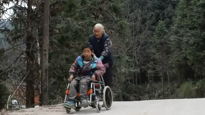 Elderly Woman Walks 15 Miles A Day To Get Disabled Grandson To School