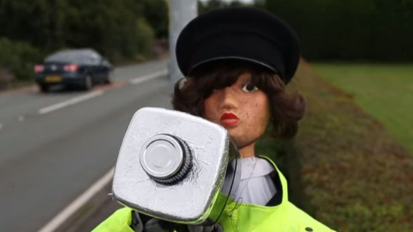 An Undercover Scarecrow Is Being Used To Slow Down Speeding Motorists
