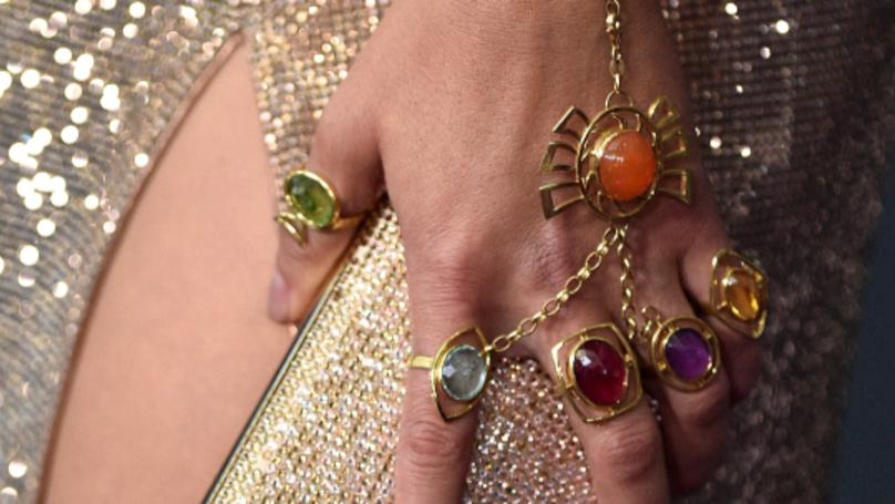 Scarlett Johansson And Brie Larson Wear Infinity Stones At Avengers Premiere