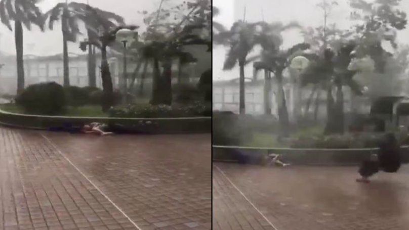 Pedestrians Swept Off Their Feet And Slammed Into Wall As They Battle 110 Mph Typhoon Mangkhut