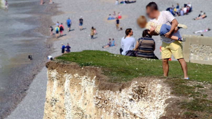 Man Dangles Child Over 400ft Drop At Notoriously Dangerous Cliff Edge
