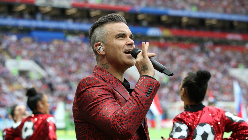 Robbie Williams Switches Up Lyrics To 'Rock DJ' At World Cup Opening Ceremony