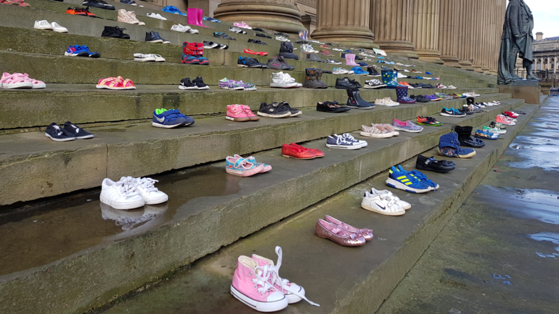 This ​Charity Placed 226 Pairs Of Shoes On Steps For Every Child Lost To Suicide