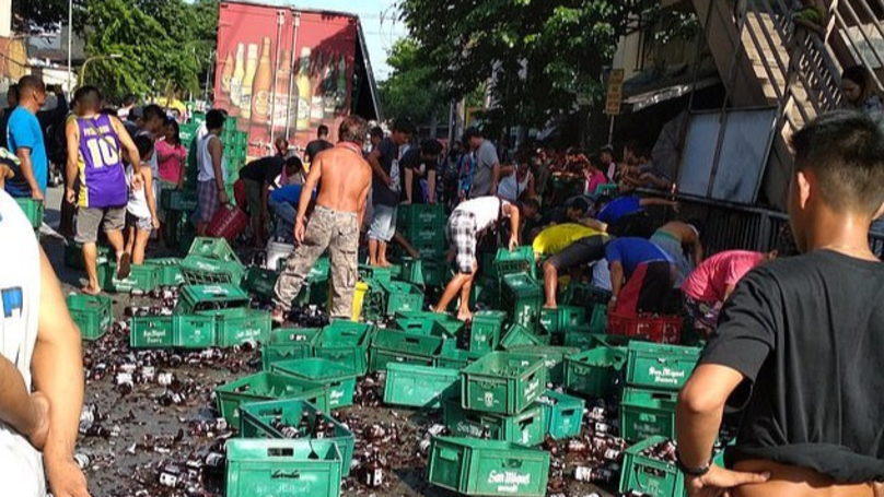 Locals Band Together To Help Clean Up Beer Bottle Disaster In Philippines