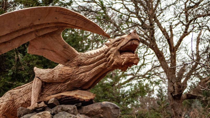 ​Police Warn Motorists About The Distracting, Wood-Carved 'Dragon Of Bethesda'