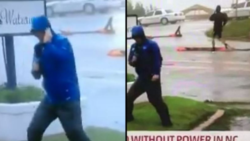 Weather Channel Reporter Filmed Being Overly-Dramatic As Men In Shorts Casually Stroll By