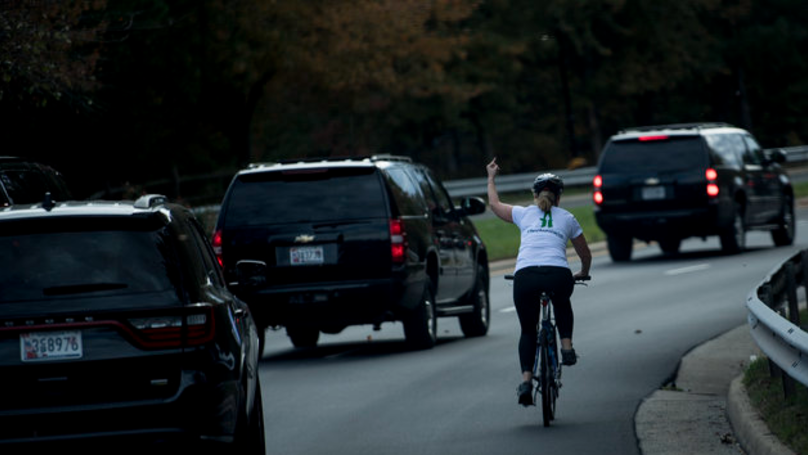 Woman Fired After Being Pictured Flipping Off President Donald Trump's Motorcade