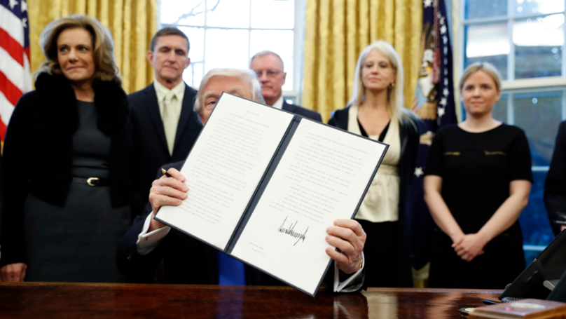 People Love Turning Donald Trump Holding His Executive Orders Into Memes