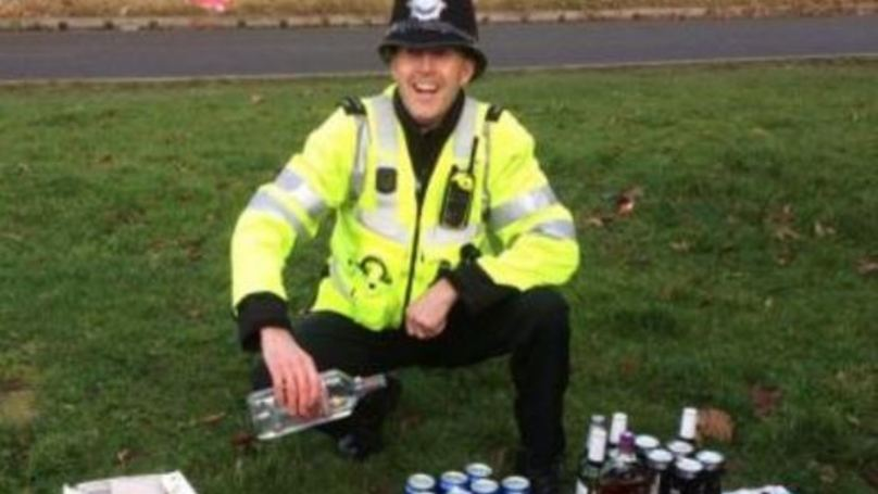 Copper Takes Picture Next To Booze Following Coach Raid