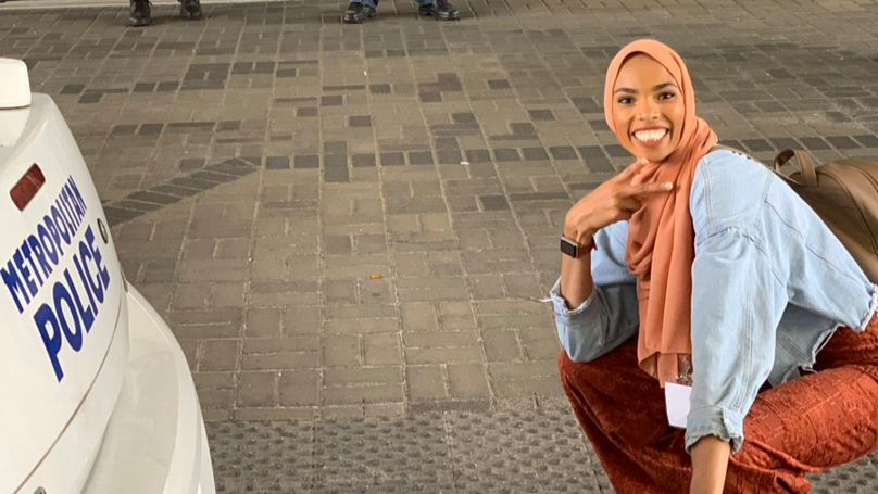 Woman Poses In Front Of Anti-Muslim Protesters To Smile 'In The Face Of Bigotry'