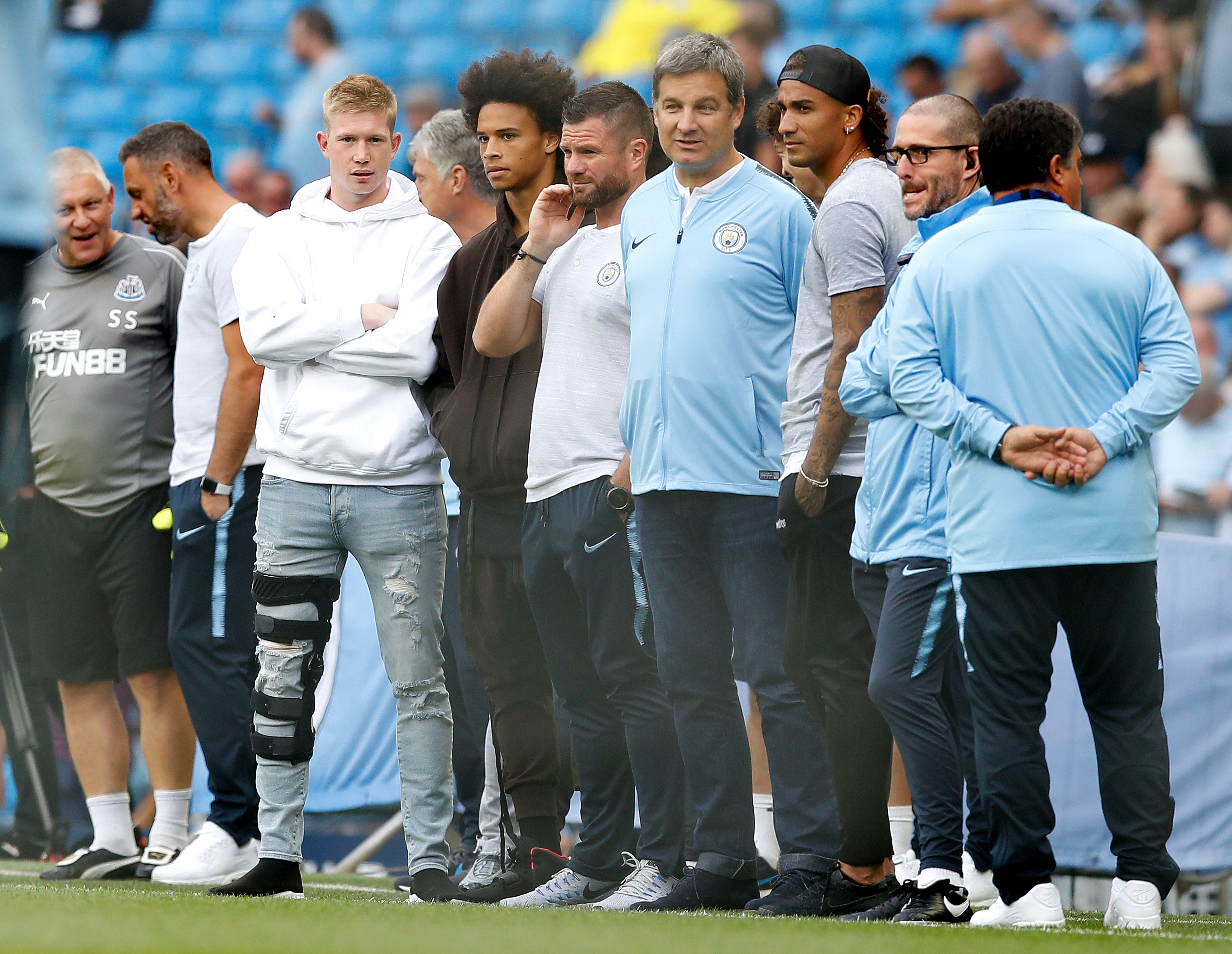 De Bruyne watching on in his knee brace. Image: PA Images