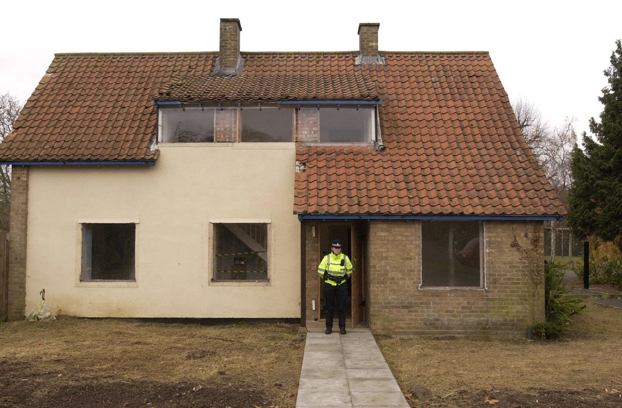 A police officer stands outside Ian Huntley's home. Credit: PA