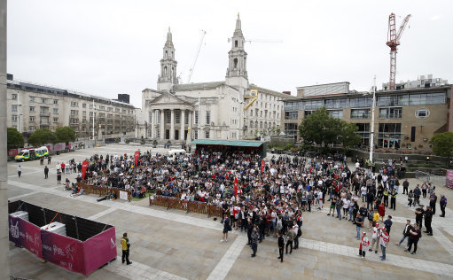 England fans watch the World Cup match between Tunisia and England on a big screen in Millennium Square, Leeds. Credit: PA