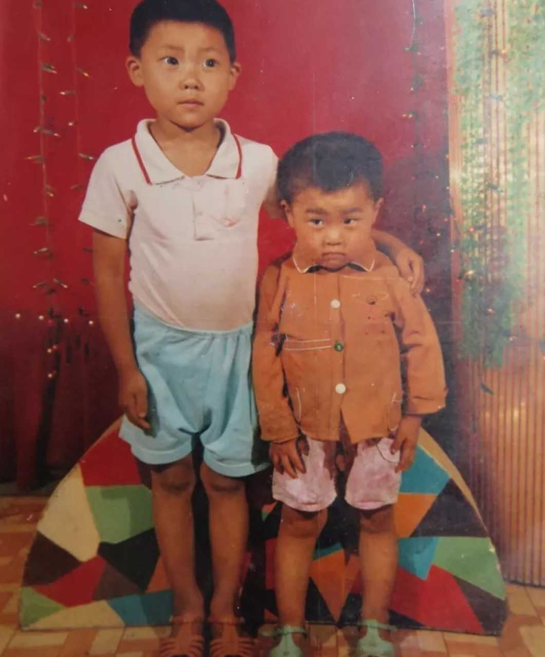 Mr Hao, right, was only eight years old when he was abducted. Credit: AsiaWire